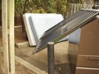 Mattresses discarded at dumpster